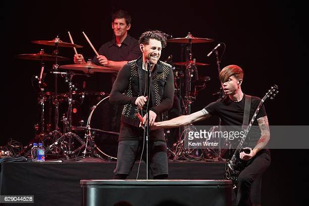 Adam Carson Davey Havok and Jade Puget of the band AFI perform onstage at 1067 KROQ Almost Acoustic Christmas 2016 Night 1 at The Forum on December...