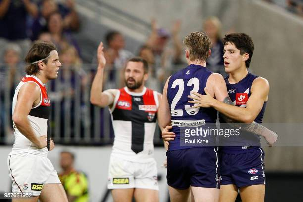 Adam Cerra of the Dockers celebrates a goal with Cam McCarthy of the Dockers during the round eight AFL match between the Fremantle Dockers and the...