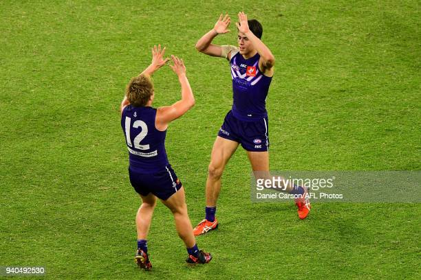 Adam Cerra of the Dockers celebrates a goal with Mitchell Crowden of the Dockers during the 2018 AFL round 02 match between the Fremantle Dockers and...