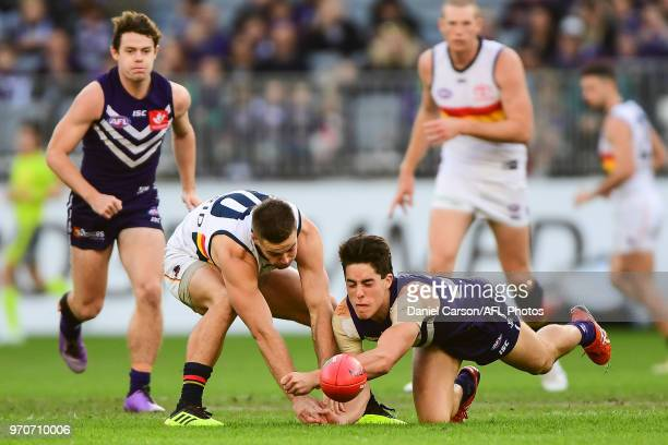 Adam Cerra of the Dockers dives for the ball during the 2018 AFL round 12 match between the Fremantle Dockers and the Adelaide Crows at Optus Stadium...