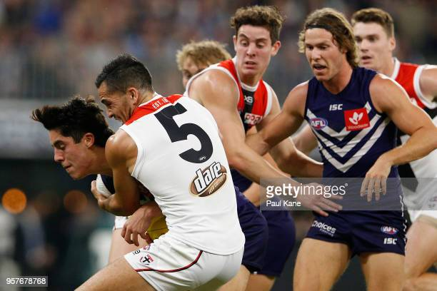 Adam Cerra of the Dockers gets tackled by Shane Savage of the Saints during the round eight AFL match between the Fremantle Dockers and the St Kilda...
