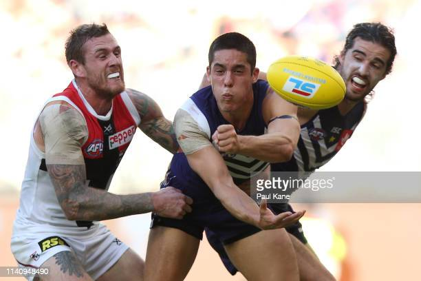 Adam Cerra of the Dockers handballs during the round three AFL match between the Fremantle Dockers and the St Kilda Saints at Optus Stadium on April...