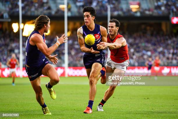 Adam Cerra of the Dockers handpasses the ball during the 2018 AFL round 02 match between the Fremantle Dockers and the Essendon Bombers at Optus...