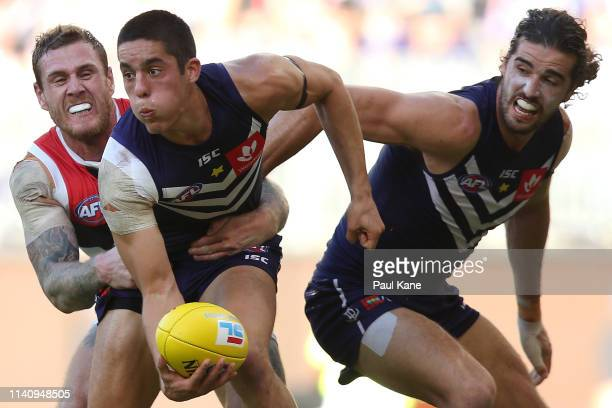 Adam Cerra of the Dockers looks to handball during the round three AFL match between the Fremantle Dockers and the St Kilda Saints at Optus Stadium...