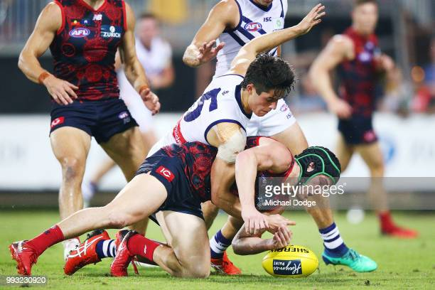 Adam Cerra of the Dockers tackled Angus Brayshaw of the Demons during the round 16 AFL match between the Melbourne Demons and the Fremantle Dockers...