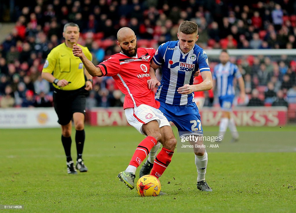 Adam Chambers of Walsall and Ryan Colclough of Wigan Athletic during the Sky Bet League One match between Walsall and Wigan Athletic at Bescot Stadium on February 20, 2016 in Walsall, England.
