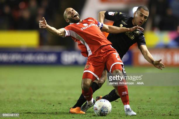 Adam Chambers of Walsall is fouled by James Vaughan of Wigan Athletic during the Sky Bet League One match between Wigan Athletic and Walsall at...