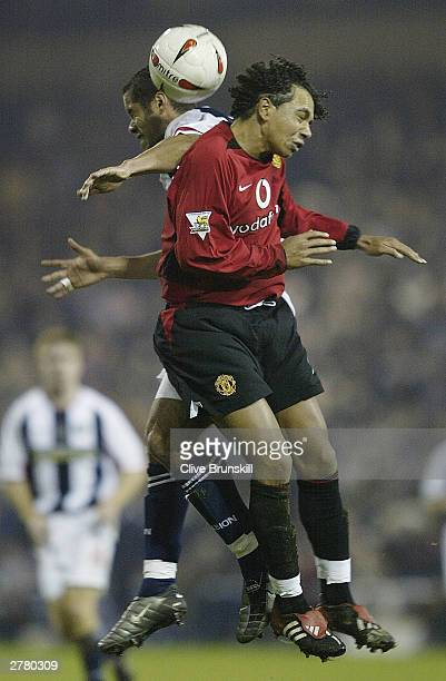 Adam Chambers of West Bromwich Albion beats Kieran Richardson of Manchester United to the ball during the Carling Cup fourth round match between West...