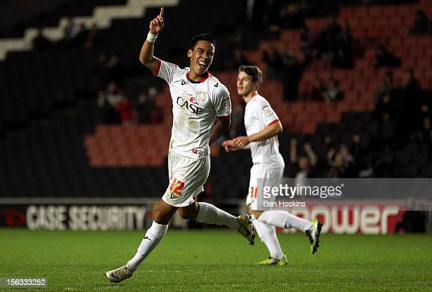 Adam Chicksen of MK Dons celebrates after scoring his team's sixth goal of the game during the FA Cup First Round Replay match between MK Dons and...