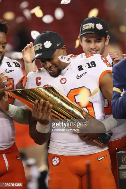 Adam Choice of the Clemson Tigers celebrates his teams 4416 win over the Alabama Crimson Tide with the trophy in the CFP National Championship...