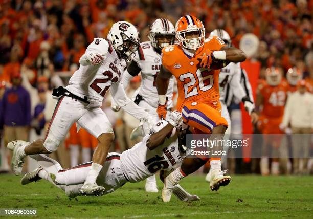 Adam Choice of the Clemson Tigers gets away from Rashad Fenton of the South Carolina Gamecocks during their game at Clemson Memorial Stadium on...