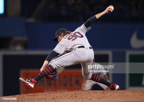 Adam Cimber of the Cleveland Indians delivers a pitch in the eighth inning during MLB game action against the Toronto Blue Jays at Rogers Centre on...
