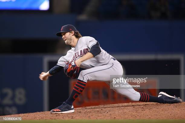 Adam Cimber of the Cleveland Indians delivers a pitch in the eleventh inning during MLB game action against the Toronto Blue Jays at Rogers Centre on...