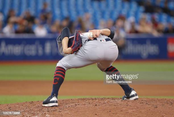 Adam Cimber of the Cleveland Indians sets himself on the mound before delivering a pitch in the seventh inning during MLB game action against the...