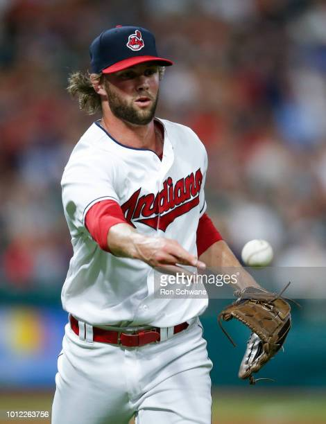 Adam Cimber of the Cleveland Indians throws out Jake Cave of the Minnesota Twins at first base during the seventh inning at Progressive Field on...