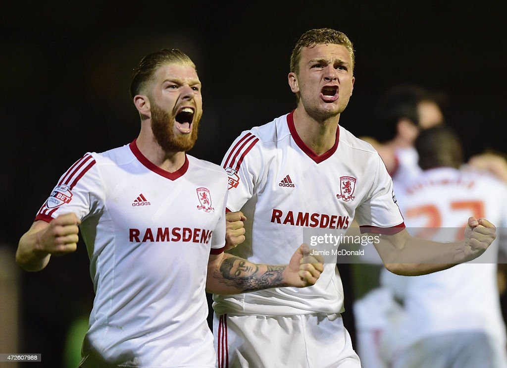 Adam Clayton (L) and Ben Gibson of Middlesbrough celebrate during the Sky Bet Championship Playoff semi-final first leg match between Brentford and Middlesbrough at Griffin Park on May 8, 2015 in Brentford, England.