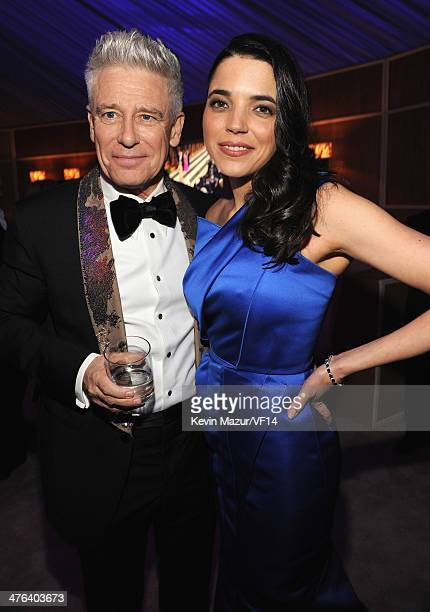 Adam Clayton and Mariana Teixeira de Carvalho attend the 2014 Vanity Fair Oscar Party Hosted By Graydon Carter on March 2 2014 in West Hollywood...