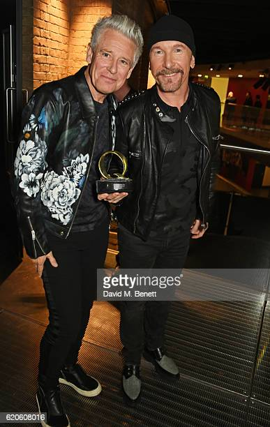 Adam Clayton and The Edge accepting the Best Live Act award on behalf of U2 attend The Stubhub Q Awards 2016 at The Roundhouse on November 2 2016 in...