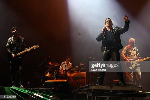 Adam Clayton Bono Larry Mullen Jr and The Edge of U2 perform at the Glastonbury Festival at Worthy Farm Pilton on June 24 2011 in Glastonbury England...