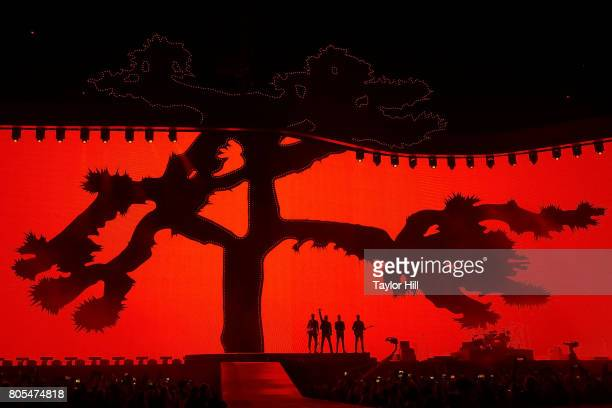 Adam Clayton Bono Larry Mullen Jr and The Edge of U2 perform during 'The Joshua Tree Tour 2017' at MetLife Stadium on June 28 2017 in East Rutherford...