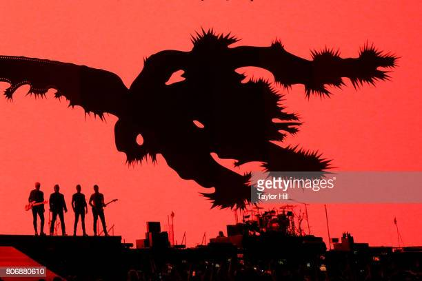Adam Clayton Bono Larry Mullen Jr and The Edge of U2 perform during 'The Joshua Tree Tour 2017' at MetLife Stadium on June 29 2017 in East Rutherford...