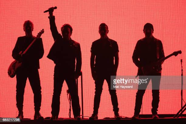 Adam Clayton Bono Larry Mullen Jr and The Edge of U2 perform on stage during the 'Joshua Tree Tour 2017' at CenturyLink Field on May 14 2017 in...
