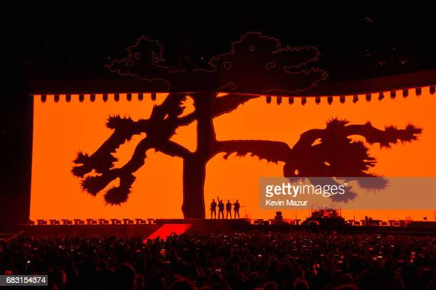 Adam Clayton Bono Larry Mullen Jr and The Edge perform onstage during U2 'Joshua Tree Tour 2017' at CenturyLink Field on May 14 2017 in Seattle...
