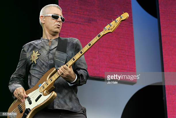 Adam Clayton from the band U2 performs on stage at Live 8 London in Hyde Park on July 2 2005 in London England The free concert is one of ten...