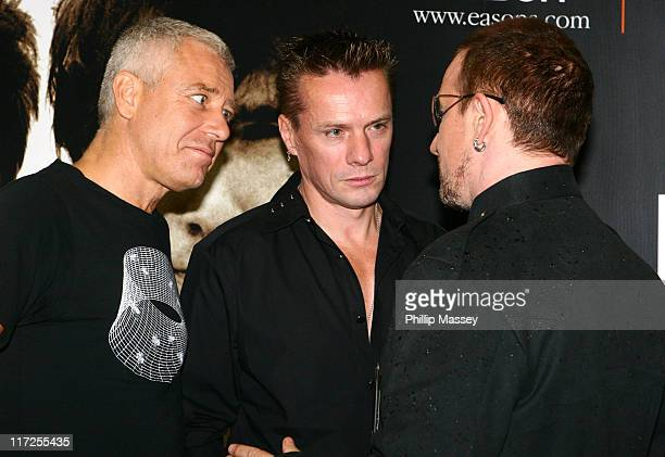 Adam Clayton Larry Mullen and Bono during U2 Book Signing and Photocall September 22 2006 at Eathan's Bookstore in Dublin Great Britain