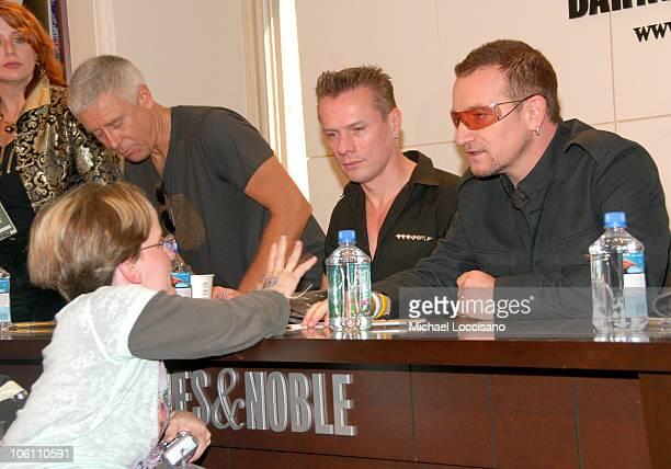 Adam Clayton Larry Mullen Jr and Bono of U2 and Fan