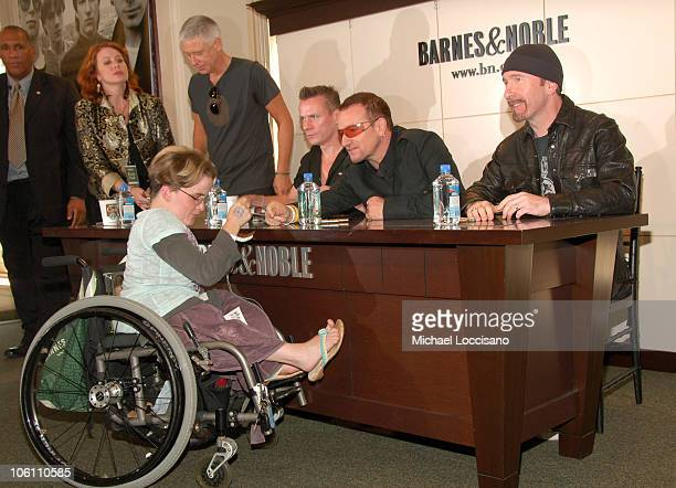 Adam Clayton Larry Mullen Jr Bono and The Edge and Fan