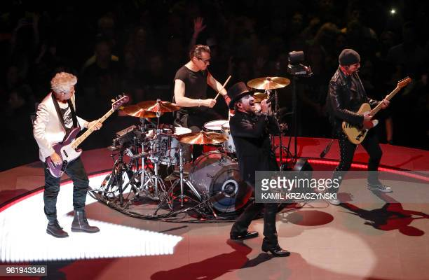 Adam Clayton Larry Mullen Jr Bono and The Edge of the Irish rock band U2 perform during the Experience Innocence tour at the United Center in Chicago...