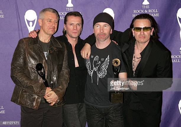 Adam Clayton Larry Mullen Jr Bono and The Edge of U2 inductees