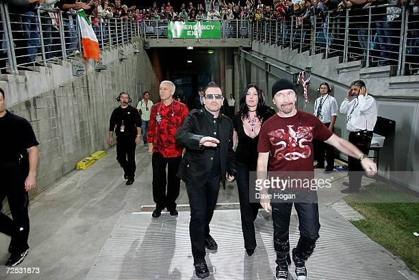 Adam Clayton Larry Mullen Jr The Edge and Bono of U2 walk to the stage ahead of their concert at the first of three rescheduled Sydney dates on their...