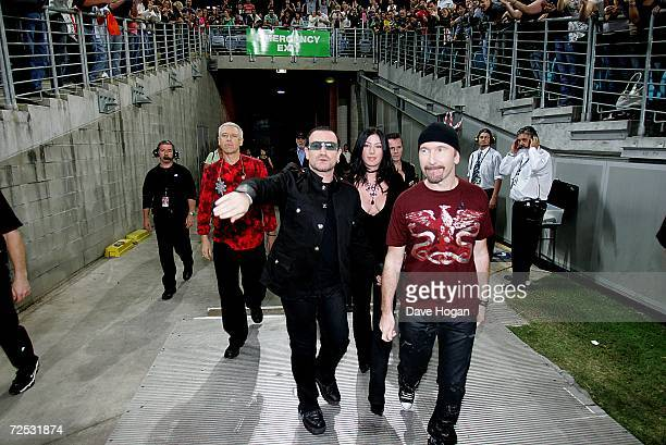 Adam Clayton, Larry Mullen Jr, The Edge and Bono of U2 walk to the stage ahead of their concert at the first of three rescheduled Sydney dates on...
