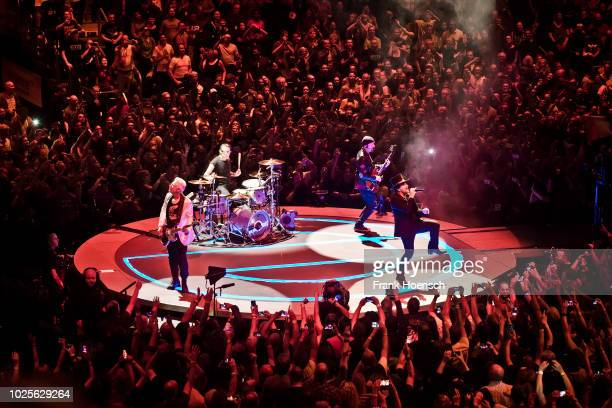 Adam Clayton Larry Mullen junior The Edge and Bono of the Irish band U2 perform live on stage during a concert at the MercedesBenz Arena on August 31...
