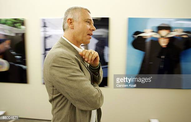 Adam Clayton member of U2 attends photographer Anton Corbijn's exhibition with pictures of rock band U2 July 6 2005 in Berlin Germany The exhibition...
