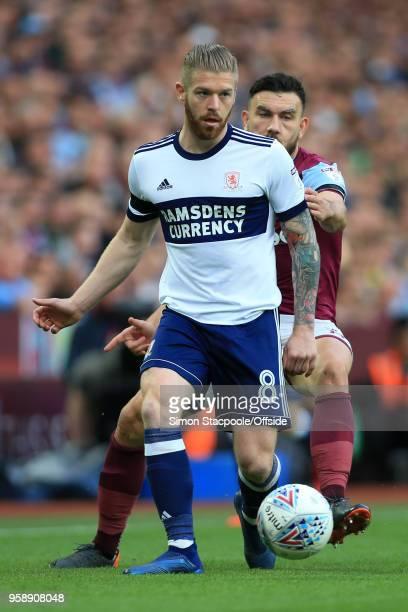 Adam Clayton of Boro battles with Robert Snodgrass of Villa during the Sky Bet Championship Play Off Semi Final Second Leg match between Aston Villa...
