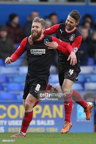 Adam Clayton of Huddersfield Town celebrates his goal with team mate Oliver Norwood during the Sky Bet Championship match between Birmingham City and...