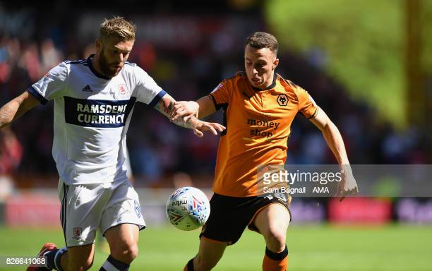 Adam Clayton of Middlesborough and Leo Bonatini of Wolverhampton Wanderers during the Sky Bet Championship match between Wolverhampton and...
