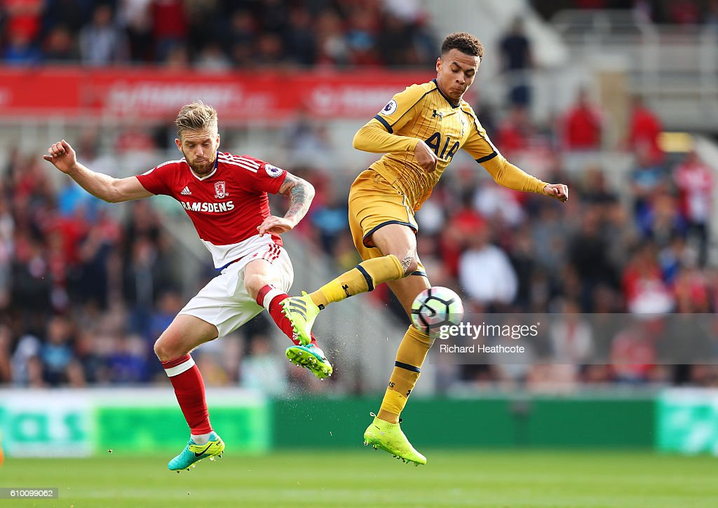 Adam Clayton of Middlesbrough (L) and Dele Alli of Tottenham Hotspur (R) battle for possession during the Premier League match between Middlesbrough and Tottenham Hotspur at the Riverside Stadium on September 24, 2016 in Middlesbrough, England.