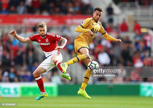 Adam Clayton of Middlesbrough and Dele Alli of Tottenham Hotspur battle for possession during the Premier League match between Middlesbrough and...