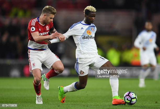 Adam Clayton of Middlesbrough and Dider N'dong of Sunderland during the Premier League match between Middlesbrough and Sunderland at the Riverside...