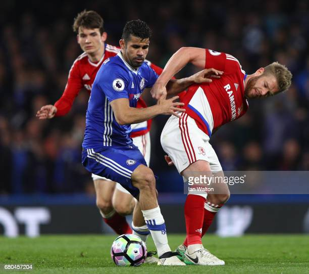 Adam Clayton of Middlesbrough and Diego Costa of Chelsea clash during the Premier League match between Chelsea and Middlesbrough at Stamford Bridge...