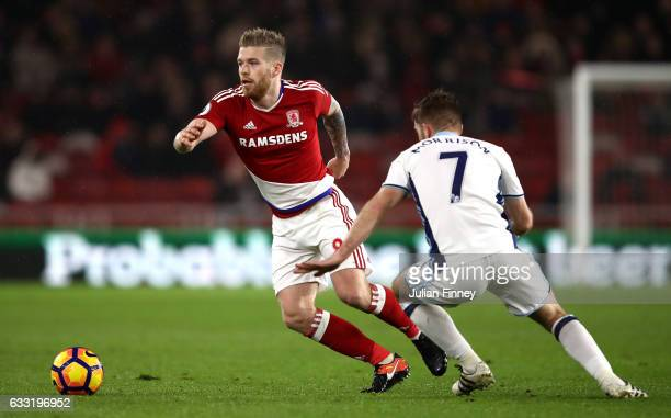 Adam Clayton of Middlesbrough and James Morrison of West Bromwich Albion compete for the ball during the Premier League match between Middlesbrough...