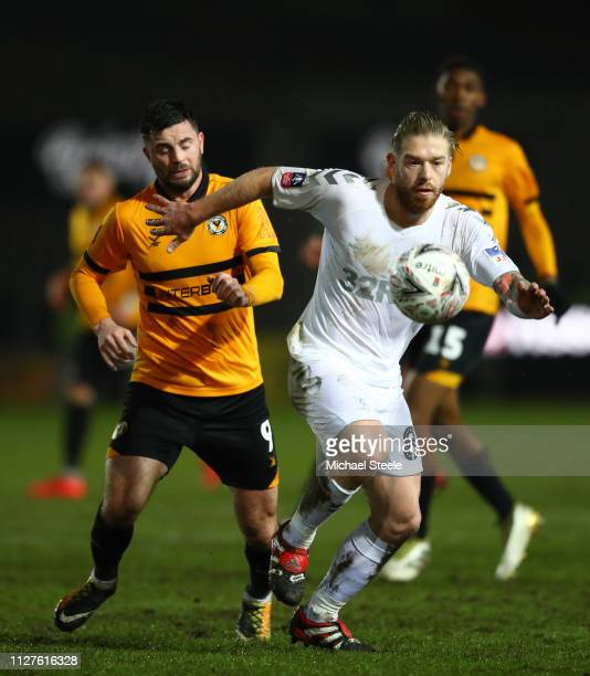 Adam Clayton of Middlesbrough and Padraig Amond of Newport County clash during the FA Cup Fourth Round Replay match between Newport County AFC and...