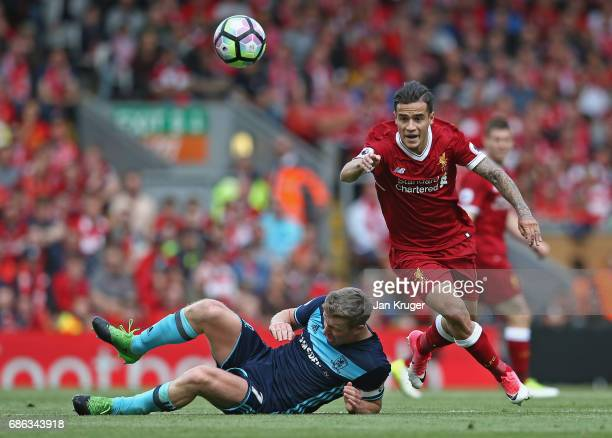 Adam Clayton of Middlesbrough and Philippe Coutinho of Liverpool in action during the Premier League match between Liverpool and Middlesbrough at...