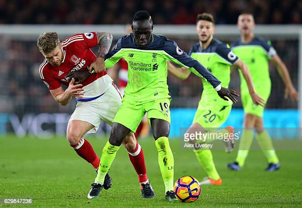 Adam Clayton of Middlesbrough and Sadio Mane of Liverpool battle for possession during the Premier League match between Middlesbrough and Liverpool...