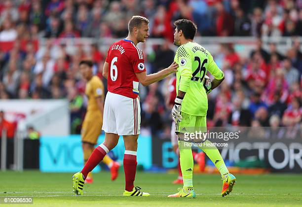 Adam Clayton of Middlesbrough argues with his goalkeeper Victor Valdes of Middlesbrough during the Premier League match between Middlesbrough and...