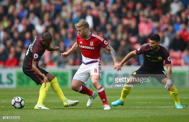 Adam Clayton of Middlesbrough attempts to get past Fernandinho of Manchester City during the Premier League match between Middlesbrough and...